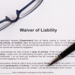 waiver of liability  on the white paper with pen